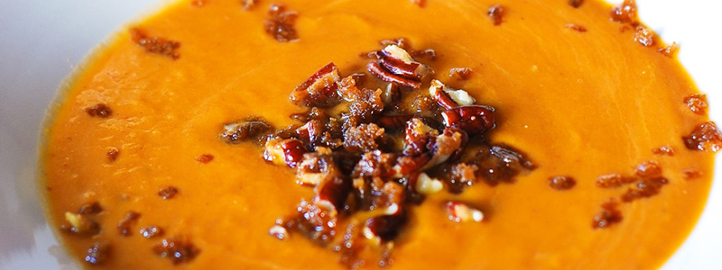 Pumpkin coconut soup with caramelized pecans. Original image from https://www.flickr.com/photos/juliasalbum/albums/72157637895181703/with/10972111165/